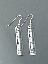 Long strip sterling silver earrings with The Silver Mesas hand stamped Bird design.