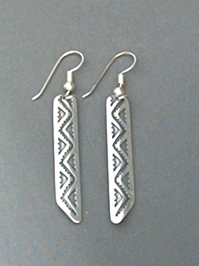 Long strip sterling silver earrings with The Silver Mesas hand stamped Lightning design.