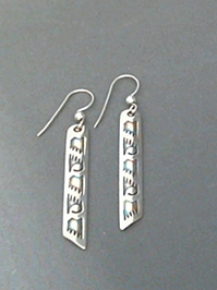 Long strip sterling silver earrings with The Silver Mesas hand stamped Wings design.