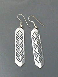 Large long strip sterling silver earrings with The Silver Mesas hand stamped Diamond Back design.