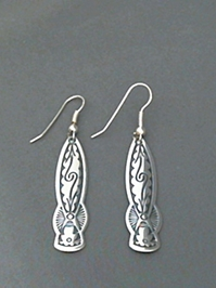 Long strip sterling silver earrings with The Silver Mesas hand stamped Pueblo Scroll design.