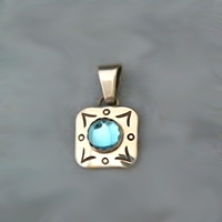 Small square sterling silver pendant with round blue topaz accented with hand stamped design work.