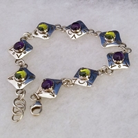 Sterling silver link bracelet with natural amethyst and peridot.  Hand made in USA.