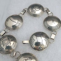 Sterling silver link belt; seventeen 1 1/2 inch pieces with Mimbres designs.