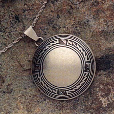 Sterling silver pendant with Mimbres Border design, 1 1/2 inch diameter.