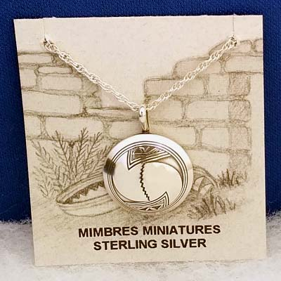 Sterling silver Mimbres pendant, 3/4 inch diameter, Wave design.