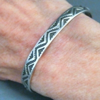 The Silver Mesas quarter-inch wide sterling silver cuff bracelet-Lightning design.  Native American made in the USA.