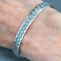 The Silver Mesas quarter-inch wide sterling silver cuff bracelet-Scallop Rope design.  Native American made in the USA.