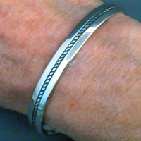 The Silver Mesas quarter-inch wide sterling silver cuff bracelet-Single Twist design.  Native American made in the USA.
