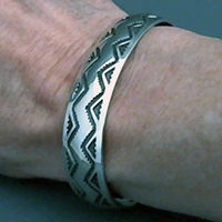The Silver Mesas half-inch wide sterling silver cuff bracelet.  Hand stamped Lightning design.  Native American made.