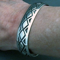 The Silver Mesas half-inch wide sterling silver cuff bracelet.  Hand stamped Diamond Back design.  Native American made.
