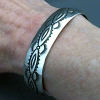 The Silver Mesas half-inch wide sterling silver cuff bracelet.  Hand stamped Navajo Scallop design.  Native American made.