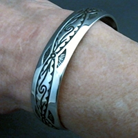 The Silver Mesas half-inch wide sterling silver cuff bracelet.  Hand stamped Pueblo Scroll design.  Native American made.