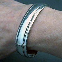 The Silver Mesas half-inch wide sterling silver cuff bracelet.  Hand stamped Double Twist design.  Native American made.