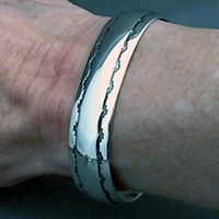 The Silver Mesas half-inch wide sterling silver cuff bracelet.  Hand stamped Mesa Pueblo design.  Native American made.
