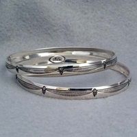 Sterling silver bangle with hand stamped Feather design.  Native American made.