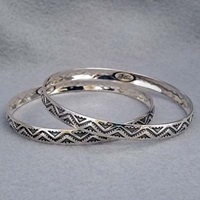 Sterling silver bangle with hand stamped Lightning design.  Native American made.