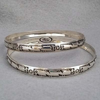 Sterling silver bangle with hand stamped Bird design.  Native American made.