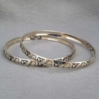 Sterling silver bangle with hand stamped Wings design.  Native American made.