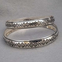 Sterling silver bangle with hand stamped Butterfly design.  Native American made.