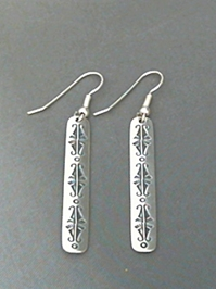 Long strip sterling silver earrings with The Silver Mesas hand stamped Butterfly design.