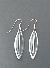Long strip sterling silver earrings with The Silver Mesas hand stamped Feather design.
