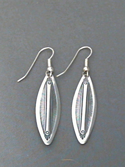 Long strip sterling silver earrings with The Silver Mesa's hand stamped Feather design.