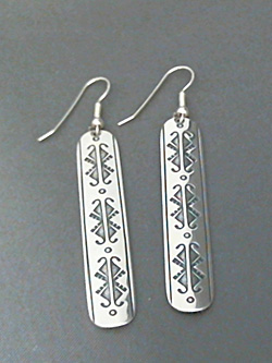 Large long strip sterling silver earrings with The Silver Mesa's hand stamped Butterfly design.