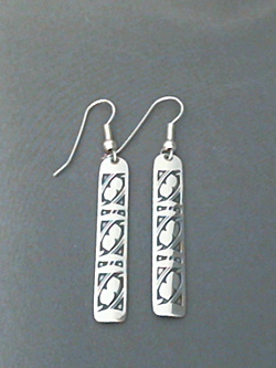 Long strip sterling silver earrings with The Silver Mesa's hand stamped Fret design.