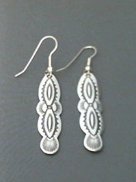Long strip sterling silver earrings with The Silver Mesas hand stamped Navajo Scallop design.