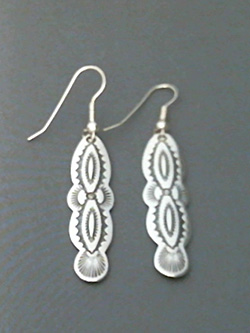 Long strip sterling silver earrings with The Silver Mesa's hand stamped Navajo Scallop design.