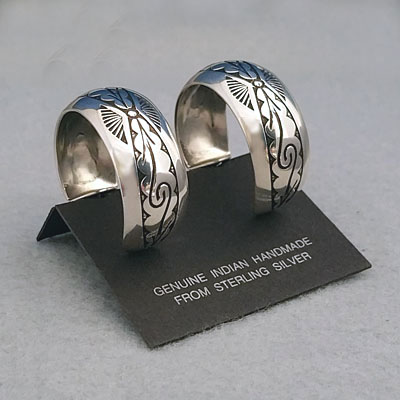 Side view-Sterling silver post hoop earrings with The Silver Mesa's Pueblo Scroll design.