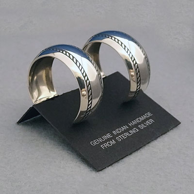 Side view-Sterling silver post hoop earrings with The Silver Mesa's Double Twist design.