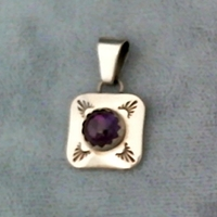 Sterling silver amethyst pendant with hand stamped design work.  Native American made.