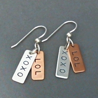 Sterling and copper earrings with XOXO and LOL.